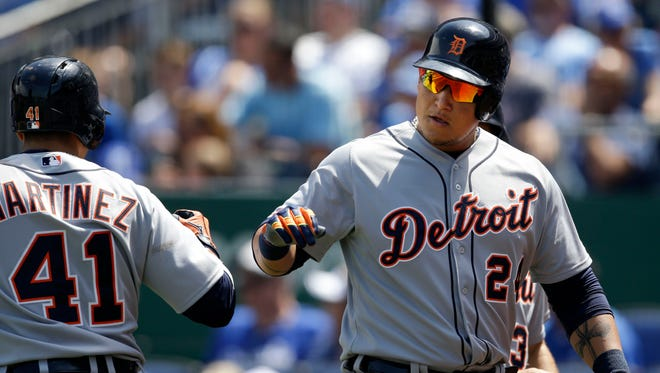 Detroit Tigers' Miguel Cabrera (24) is congratulated by teammate Victor Martinez (41) after his two-run home run off Kansas City Royals starting pitcher Jeremy Guthrie on May 3, 2015.