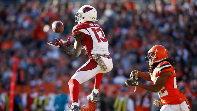 Nov 1, 2015: Arizona Cardinals wide receiver Jaron Brown (13) catches the ball in front of Cleveland Browns cornerback Tramon Williams (22) during the third quarter at FirstEnergy Stadium. The Cardinals won 34-20.