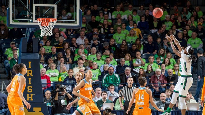 Notre Dame guard Jewell Loyd, right, shoots over Tennessee guard Andraya Carter (14) in the first half Monday.