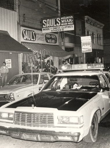 SEPTEMBER 13, 1981: This was the scene in Newport, Kentucky, Thursday night when State Police cruisers lined up on Monmouth Street for simultaneous raids of four nightspots.