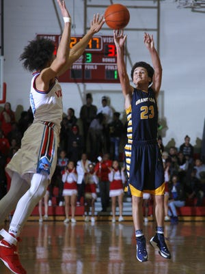 Grand Ledge's Luke Smith (23) shoots against Lansing Everett earlier this season. Smith was one of the area's top performers Friday.