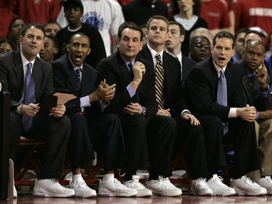FILE – Mike Schrage, far left, was part of a loaded coaching staff under Coach K (center) at Duke.
