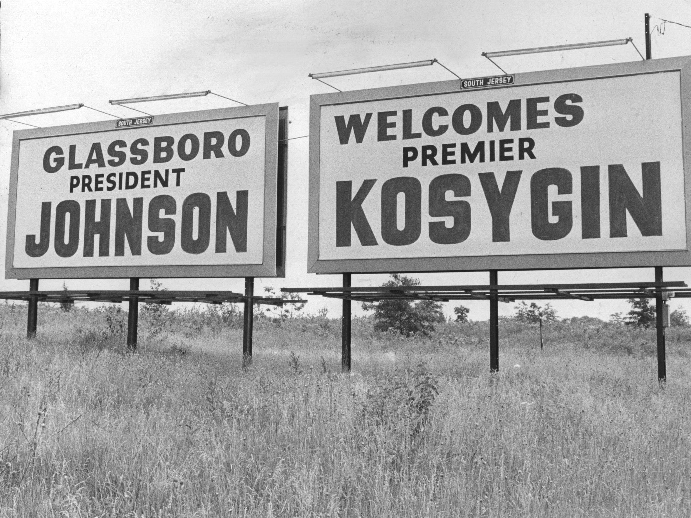 Signs welcome President Lyndon B. Johnson and Soviet Premier Alexei Kosygin to Glassboro, site of the weekend Hollybush Summit that began June 23, 1967.