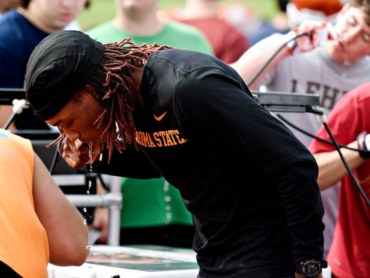 Central York's Rodrick Farley-June gets a drink of