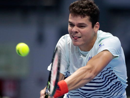 Milos Raonic of Canada returns the ball to Mikhail Youzhny of Russia during the St. Petersburg Open ATP tennis tournament match in St.Petersburg, Russia, Thursday, Sept. 22, 2016. (AP Photo/Dmitri Lovetsky)