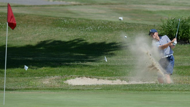 Carter Hassenplug of North East hits  from a sand trap on the 18th hole in the EDGA Junior Stroke Play Championship on Monday at Downing Golf Course in Harborcreek Township.