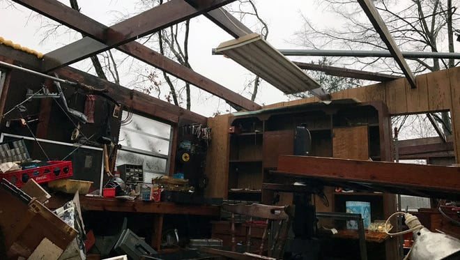 Items lie scattered about after a storm south of Mount Olive, Miss., took of the roof Monday, Jan. 2, 2017. Forecasters say damaging winds, hail and flash flooding will be possible on Monday as a storm system moves across the South.