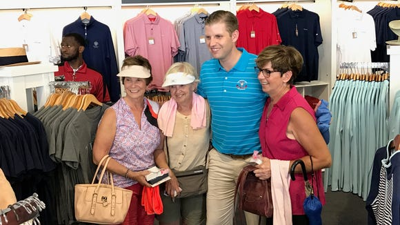 Eric Trump, son of President Donald Trump, poses for a photo with fans during the first round of the U.S. Women's Open at Trump National Golf Club in Bedminster.