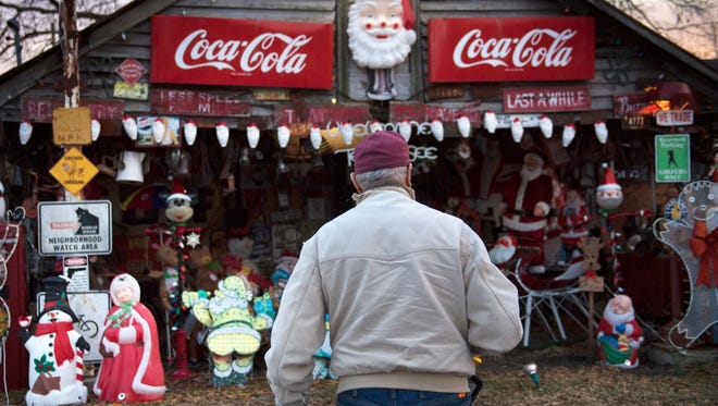 Staley Holder, of Pinson, begins his daily routine of checking the Christmas lights adorning his shed Wednesday, Dec. 13, 2017, at the corner of Circle Drive and US-45 in Pinson.