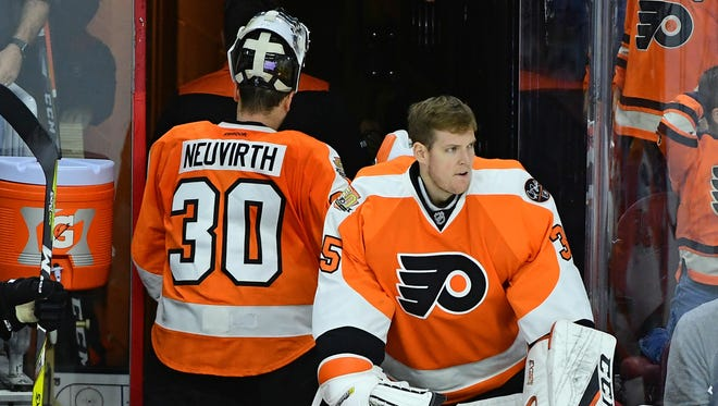 Both Steve Mason, right, and Michal Neuvirth have struggled in goal this season.