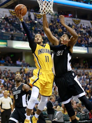 Indiana Pacers guard Monta Ellis (11) puts up  a shot defended by Miami Heat center Hassan Whiteside in the second half of an NBA basketball game, Friday, Dec. 11, 2015, in Indianapolis. Indiana won 96-83.