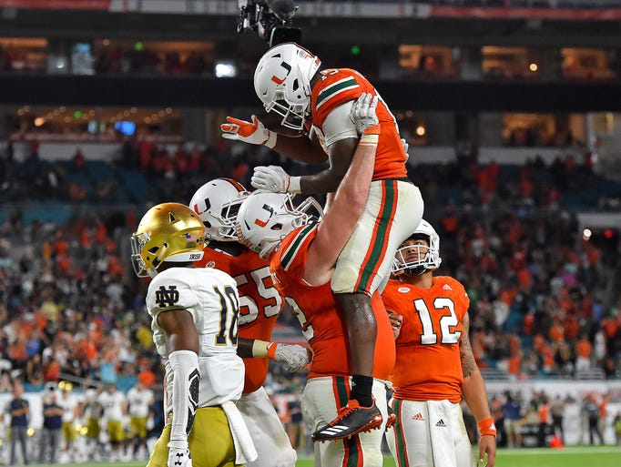 Miami Hurricanes quarterback DeeJay Dallas (13) celebrates