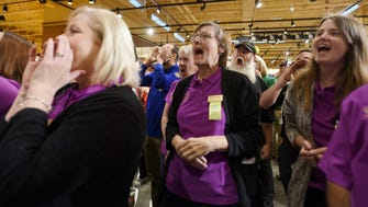 Wegmans employees share a final cheer before opening the long-awaited Montvale store at 7 a.m. on Sunday.