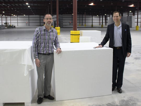 Plymouth Foam President and CEO David Bolland, right, and Vice President of Operations Mark Schuh stand in the business' newly completed 115,000 square foot addition.