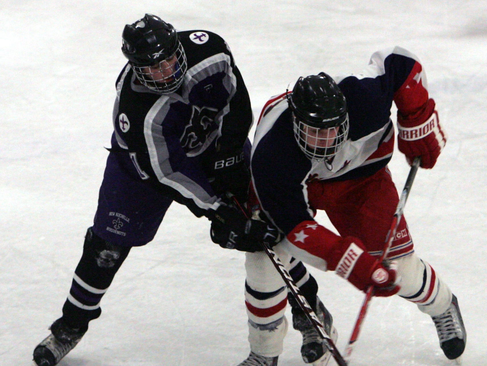 Former New Rochelle standout Richie Prunesti went toe to toe with New Jersey Devils defenseman Steve Santini (right) when they were in high school. They also played on the same New York Applecore club team. The clashed in January of 2011 at Brewster Ice Arena.