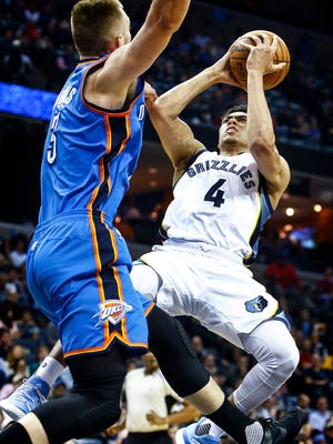 Memphis Grizzlies guard Wade Baldwin IV (right) drives for a layup against Oklahoma City Thunder defender Domantas Sabonis (left) during second quarter action at the FedExForum.
