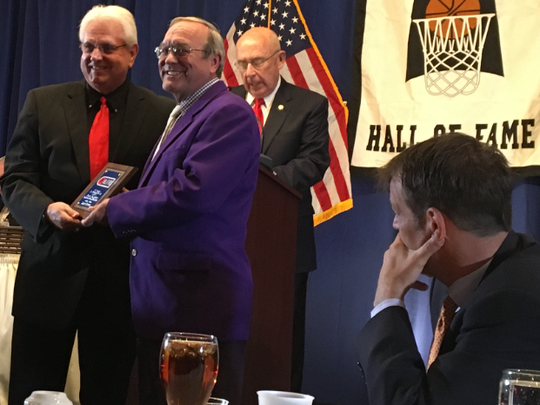 Basketball hall of fame Daryl Buente has been the equipment manager for the University of Evansville Aces for 36 years. In high school, he was the equipment manager for the undefeated North '67 basketball team. Recently, he was honored at the Indiana Basketball Hall of Fame. Denny Brady is presenting Daryl Buente his honor as Phil Eskew Jr. and Richie Hammel look on.