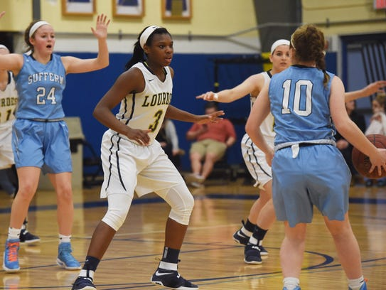 Lourdes' Rebecca Townes, left, defends while Suffern's
