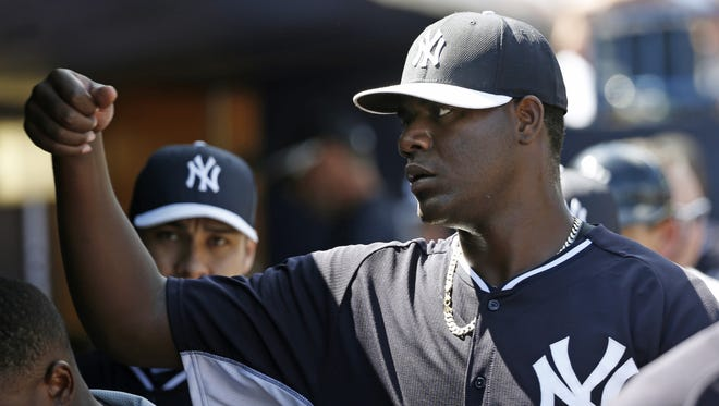 Teammates congratulate Yankees starting pitcher Michael Pineda after a spring outing against the Red Sox. After two years spent trying to come back from injury, Pineda won the fifth-starter job for the Yankees.