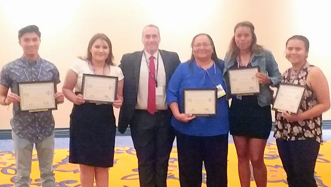 "Five Ruidoso High School seniors and one employee were recognized as ""Outstanding"" by The New Mexico Indian Education Advisory Council during an honorarium reception last week at the Inn of the Mountain Gods. Hailee Blake, Cisco Bob III, Hailey Evans, Christopher Little, Pearl Tissnolthtos and Native American Liaison Charlene Bigmouth were recognized."