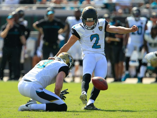 Jacksonville Jaguars kicker Jason Myers kicks a field goal from the hold of Jacksonville Jaguars punter Brad Nortman during the second half of a football game at EverBank Field on Sept. 25. The Baltimore Ravens won 19-17.