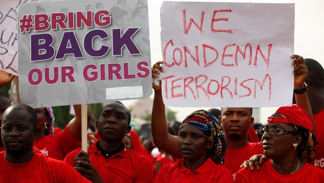 People attend a demonstration calling on the government to rescue kidnapped girls of Government Secondary Shool Chibok in Abuja, Nigeria , Thursday, May 22, 2014.