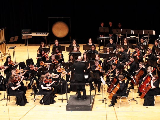 McKay High School's symphony, conducted by JJ Meyer, makes its debut in the OSAA Orchestra State Championships at the LaSells Stewart Center at Oregon State University in Corvallis on Thursday, May 12, 2016. The ensemble placed third.