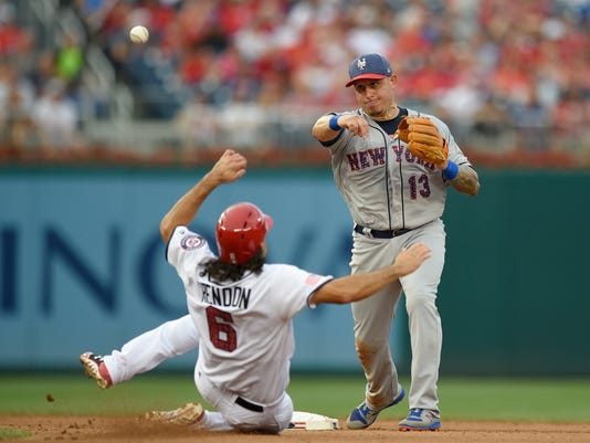 Washington Nationals' Anthony Rendon is out at second as New York Mets shortstop Asdrubal Cabrera (13) throws to first to get out Matt Wieters for a double-play during the fourth inning of a baseball game, Monday, July 3, 2017, in Washington. (AP Photo/Nick Wass)