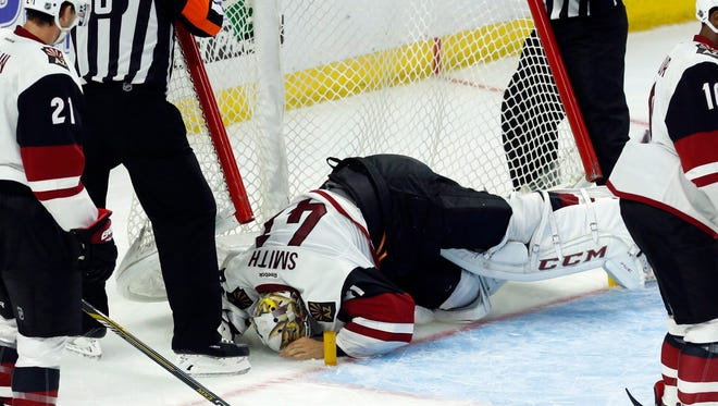 Arizona Coyote goaltender Mike Smith(41) lies injured on the ice during the third period of the team's NHL hockey game against the Arizona Coyotes on Tuesday, Oct. 18, 2016, in Ottawa, Ontario.