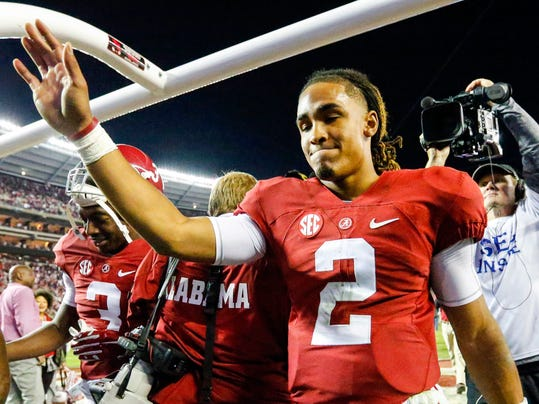 Alabama quarterback Jalen Hurts (2) waves to fans as he leaves the field after they defeated Auburn 30-12 in the Iron Bowl NCAA college football game, Saturday, Nov. 26, 2016, in Tuscaloosa, Ala. (AP Photo/Butch Dill)