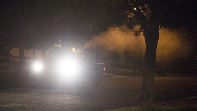 A truck deployed by Larimer County sprays mosquito insecticide on the east side of Fort Collins Wednesday, August 17, 2016.