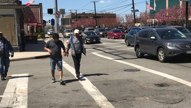 Pedestrians cross at Essex Street and Prospect Avenue in Hackensack.