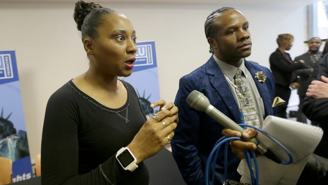 Meranda Davis, left, and Jon Marvin Levy, parents of a female inmate at Copper Lake School for Girls talk to the media after the ACLU of Wisconsin and Juvenile Law Center announce a lawsuit against Lincoln Hills School for Boys and Copper Lake  during a press conference at Urban Underground in Milwaukee Tuesday.