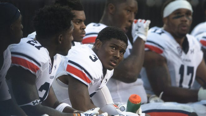 Auburn defensive back Jonathan Jones (3) looks at the scoreboard during the NCAA football game between Mississippi State and Auburn on Saturday, Oct. 11, 2014, at Davis Wade Stadium in Starkville, Miss. Mississippi State defeated Auburn 38-23.
