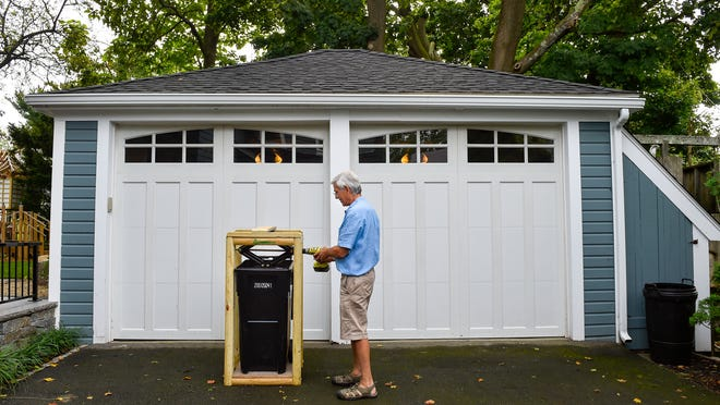 On Thursday, Sept. 3, 2020, Dr. Larry Block demonstrates the 'TrashMasher48,' a compactor configured and tailored to smash trash in Swampscott's new 35-gallon trash barrels.