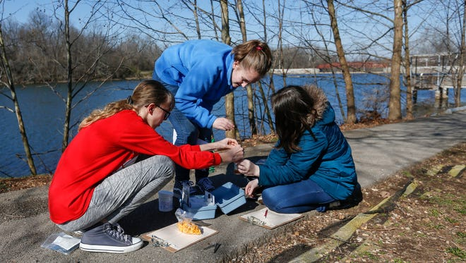 From left, Evalee Lowrey, 13, Dein Gentry, 13, and Kylee Hubbell, 13, students at Reed Academy, perform a dissolved oxygen test on lake water during a field trip at the Watershed Center on Monday, Feb. 27, 2017.