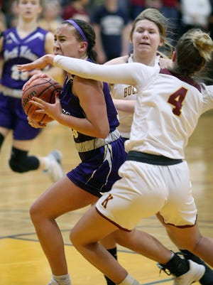 North Kitsap player Olivia Selembo drives past Kingston player Avy Hiner Friday night at Kingston.