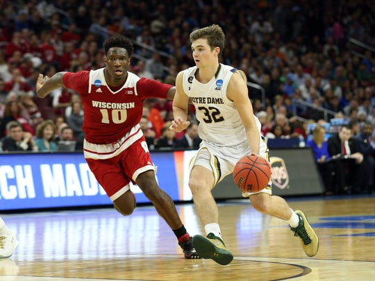 Mar 25, 2016; Philadelphia, PA, USA; Notre Dame Fighting Irish guard Steve Vasturia (32) drives against Wisconsin Badgers forward Nigel Hayes (10) during the second half in a semifinal game in the East regional of the NCAA Tournament at Wells Fargo Center. Mandatory Credit: Bill Streicher-USA TODAY Sports