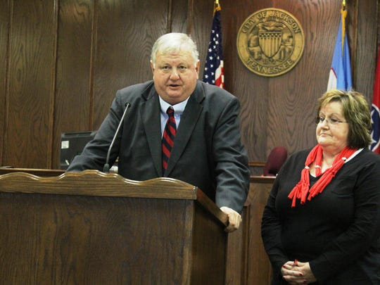 Jackson City Court Judge Blake Anderson thanks retired Sgt. Debbie Stanfill for her work with domestic violence victims during her 35-year career at a retirement reception for Stanfill on Friday.