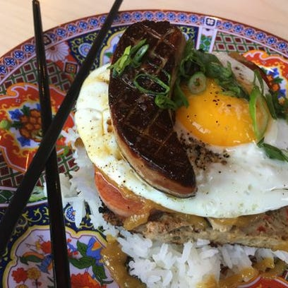 Embutido is a Filipino pork meatloaf. Chefs at Rook tuck a slice beneath Spam, a fried egg and velvety, seared foie gras.