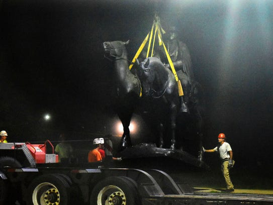 "Workers remove the Robert E. Lee and Thomas J. ""Stonewall"""