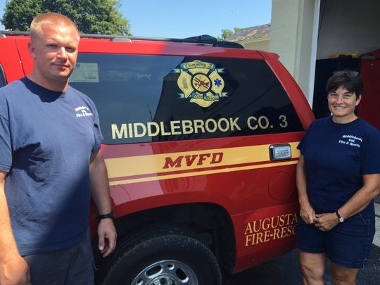 Jason Shultz and Terri Gordon, chief and president, respectively, of Middlebrook Volunteer Fire Department, pose for a photo outside the station on Wednesday, July 19, 2017.