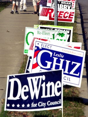 Political signage used to be disallowed on private property withing 300 feet of a polling place. That law has been ruled unconstitutional.