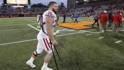 UW center Dan Voltz walks off the field after the game