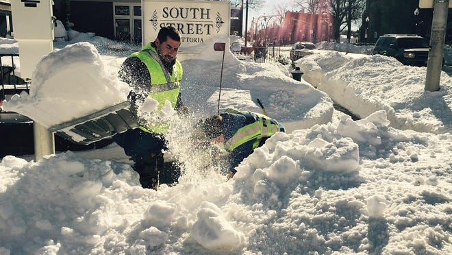 Morristown Deputy Fire Chief Jon Prachthauser shovels out one of the approximately 360 fire hydrants in Morristown after a major winter storm arriving early Saturday morning in Morris County accumulated around 30 inches of snow in the area. January 24, 2016, Morristown, NJ.
