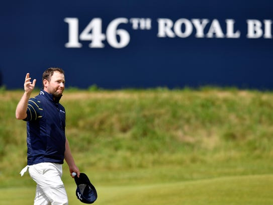 Branden Grace reacts on the 18th green during the third