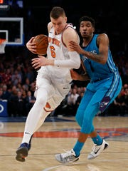 New York Knicks forward Kristaps Porzingis (6) drives