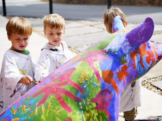 Wyatt Brazell, left, and William Roberts, both 4, paint