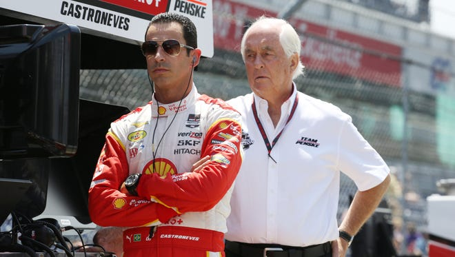 Helio Castroneves and Roger Penske watch practice from their pit box during Fast Friday for the 2015 Indianapolis 500 at Indianapolis Motor Speedway on Friday.