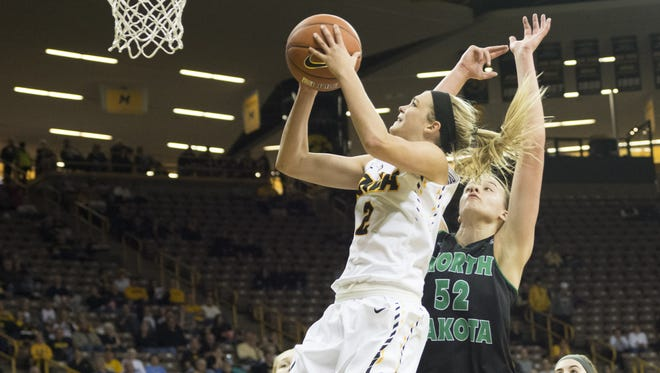 Ally Disterhoft drives around North Dakota's Stephanie Smith during the Hawkeyes' 83-61 victory at Carver-Hawkeye Arena.